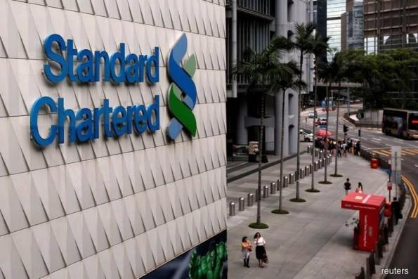 StanChart says focus is on strategy, denting merger speculation