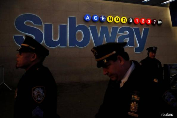 Subway bomber wounds self, three victims in New York