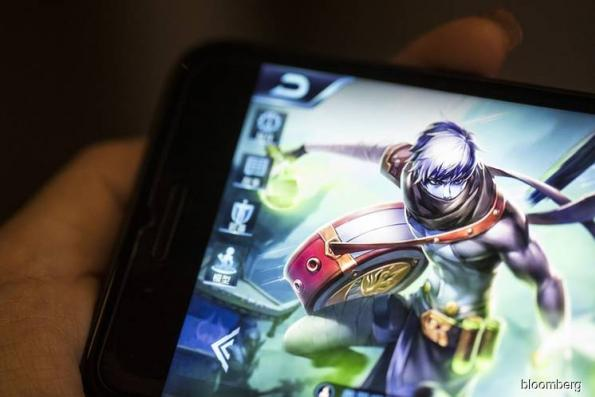 Tencent is said to slash game marketing budget amid freeze