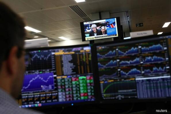 British stocks battered on Brexit deal backlash, exporters gain