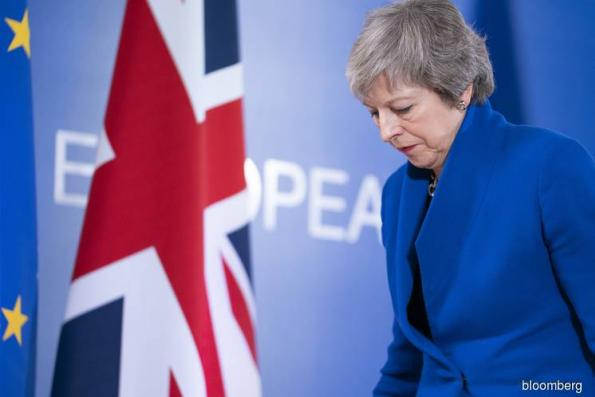 May wins some time for a final push on her rejected Brexit deal