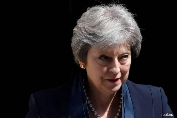 May signals Brexit no-deal not end of world