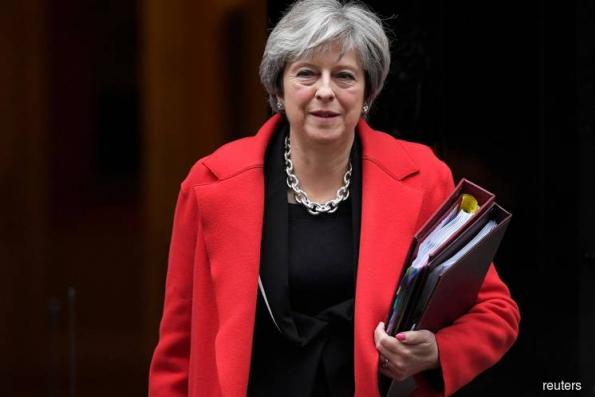 Britain's May weathers new challenges on Brexit plan, more to come