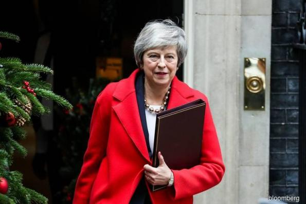 May Suffers Parliament Defeats Ahead of Key Vote