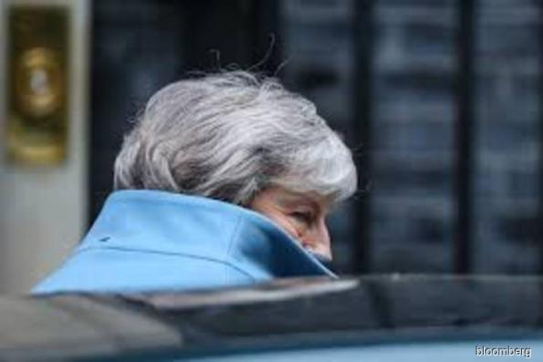 May won't ask for long delay, raising the stakes