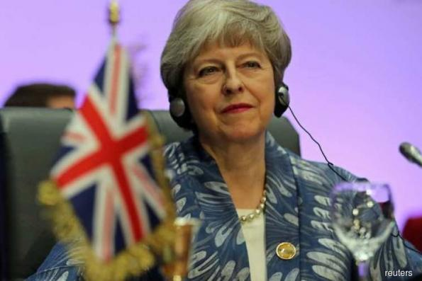 UK PM May welcomes Brexit delay, says parliament now has clear choice