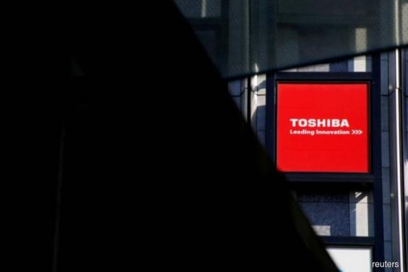 Toshiba sees annual loss of almost US$1b after tax related to chip unit sale