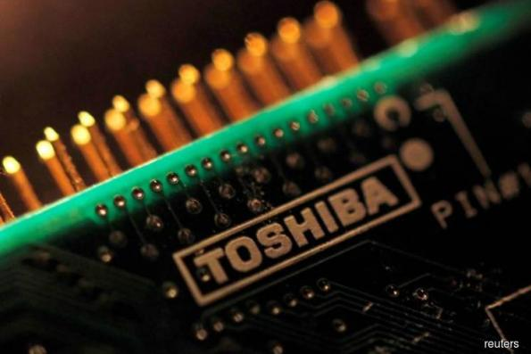Toshiba appoints ex-banker as CEO, forecasts first profit in 4 years