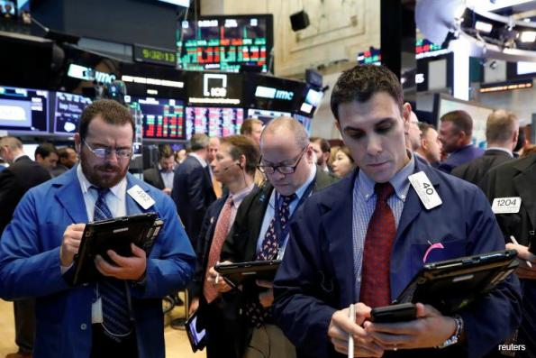 Wall St falls on investor nerves about interest rates, tech