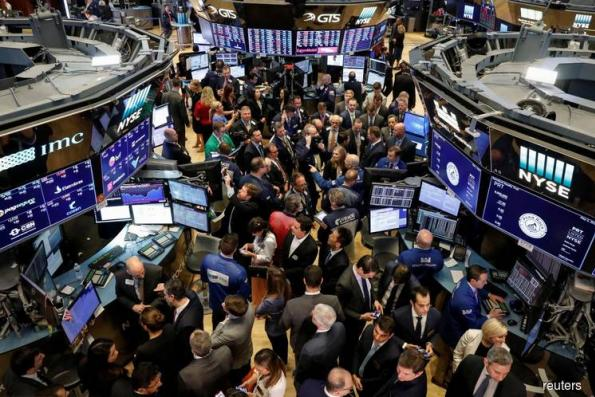 Wall St ends down slightly on trade, oil price concerns