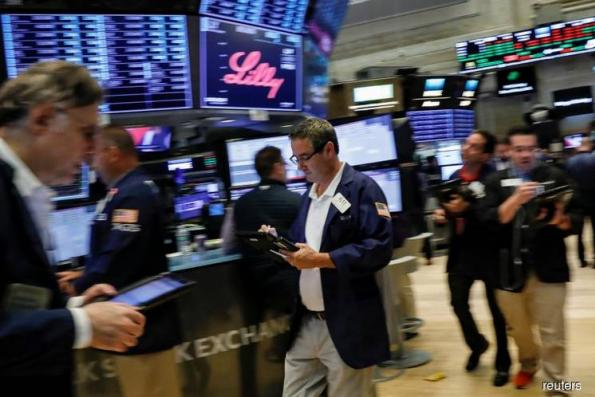 Wall St climbs on Powell comments, earnings