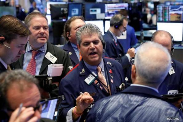Facebook sends Nasdaq tumbling, but trade optimism boosts Dow