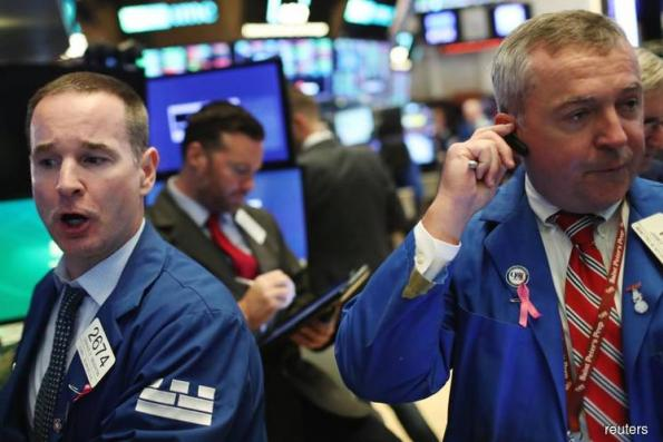 S&P, Dow edge down after Fed decision; tech boosts Nasdaq