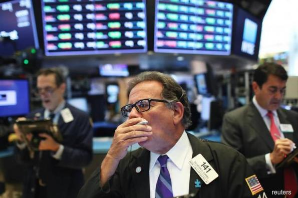 Wall St gains as upbeat earnings trump trade jitters