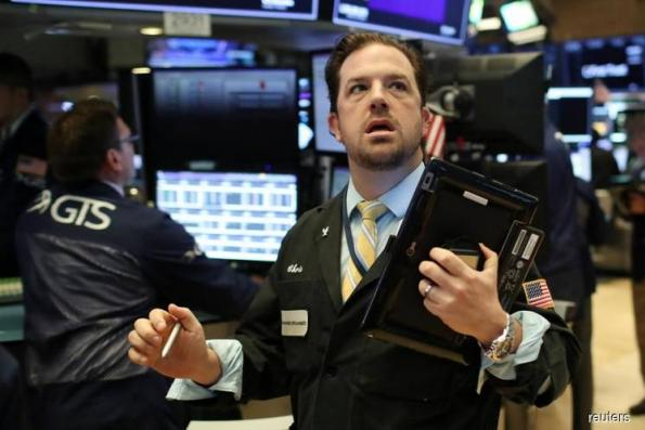 Wall St closes higher as strong earnings cheer investors
