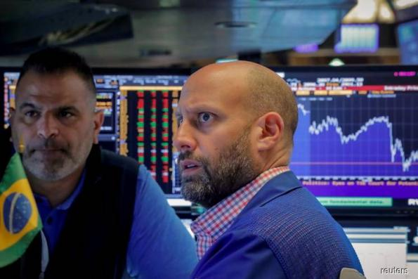 Wall Street drops as tech stocks, Nike weigh