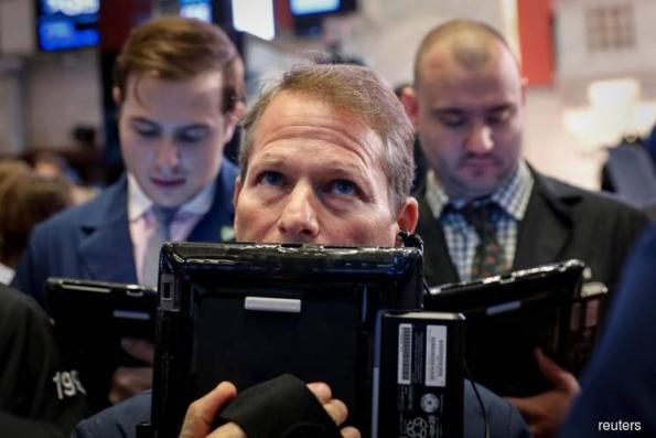 Facebook's slide stalls Intel-led advance on Wall Street
