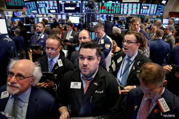 Dow closes at record but Facebook drags on S&P, Nasdaq