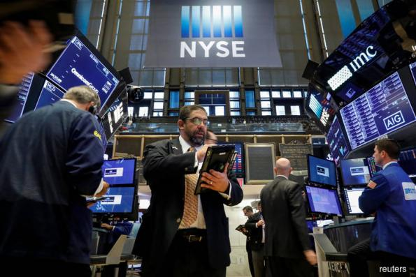 Financials lift Wall Street, but rate worry caps gains