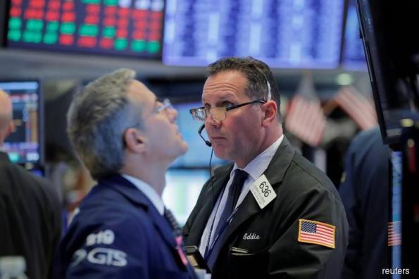 Wall Street edges lower on global worries despite falling yields