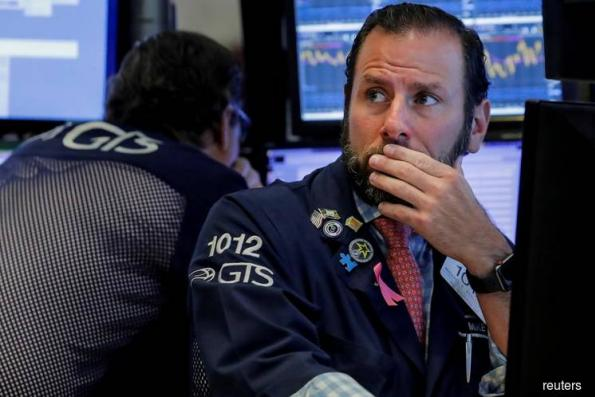 Wall St slides as Saudi Arabia, Italy add to economic concerns