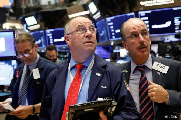 S&P falls on interest rate, trade concerns; P&G lifts Dow