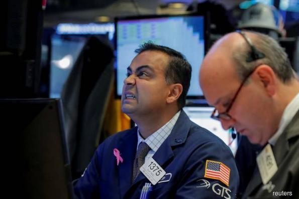 Dow, S&P fall as earnings season picks up; tech boosts Nasdaq