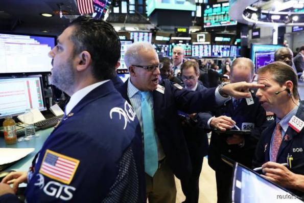 Wall St ends last day of haunted October in the black
