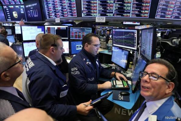 Retail disappointments, energy decline hit Wall Street