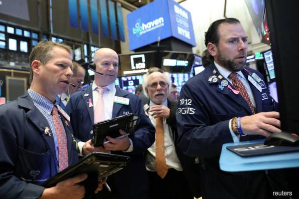 Wall St rallies as Powell hints at slowing rate hikes