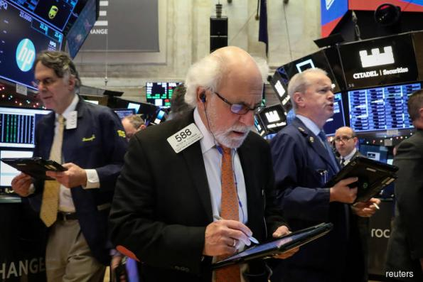 Wall Street tumbles, spooked by growth and trade worries
