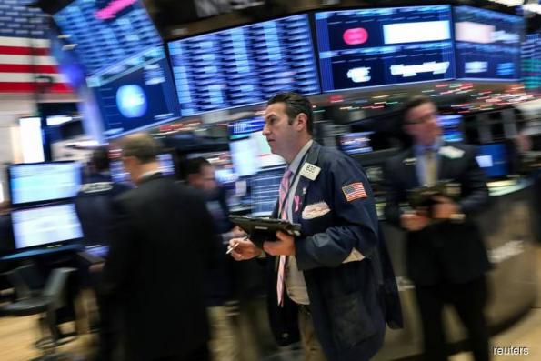 Wall St tumbles on global growth worries, J&J decline