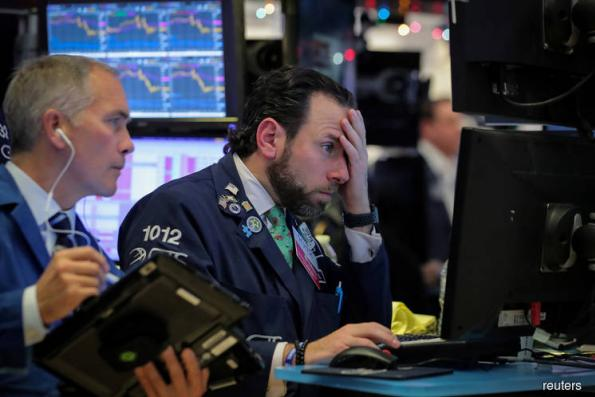 Wall St turns negative after Fed press conference