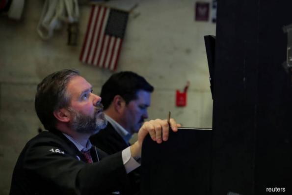 Wall St slides on Fed plans; Nasdaq flirts with bear territory