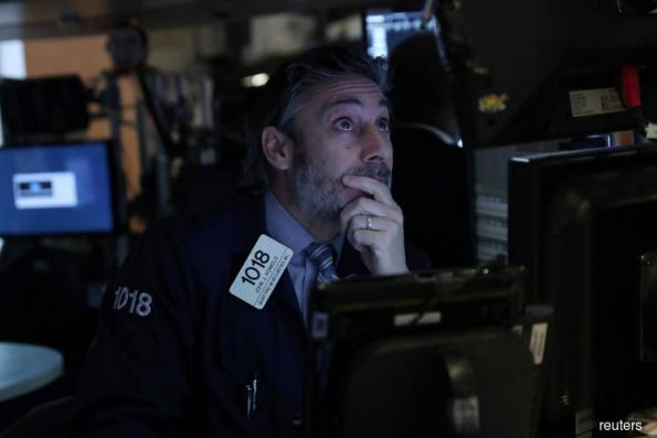 Wall St ekes out gains in rocky start to 2019