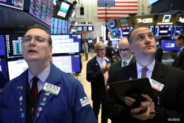 Wall Street rally pauses after underwhelming revenue forecasts