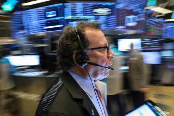 Wall St climbs on trade hopes, government budget deal