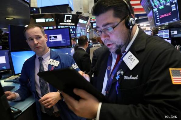 Wall St drops after weak data, healthcare slump