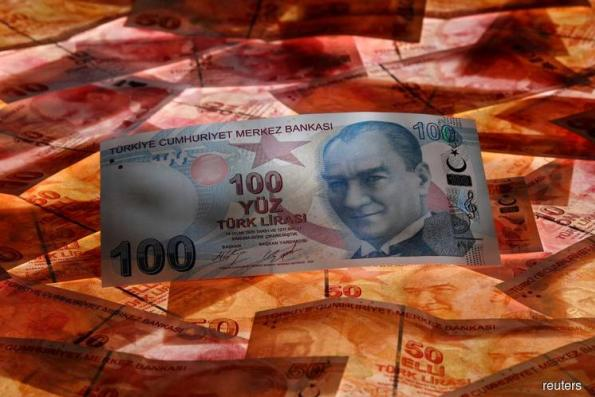 Turkish lira firms before finance minister's presentation