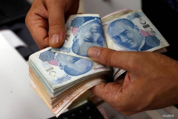 Turkey Probes JPMorgan After Lira's Worst Slide Since 2018 Crash