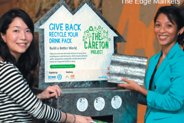 Turning-drink-cartons-into-roof-tiles