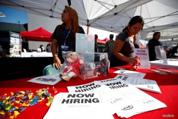 U.S. jobless claims drop to near 45-year low