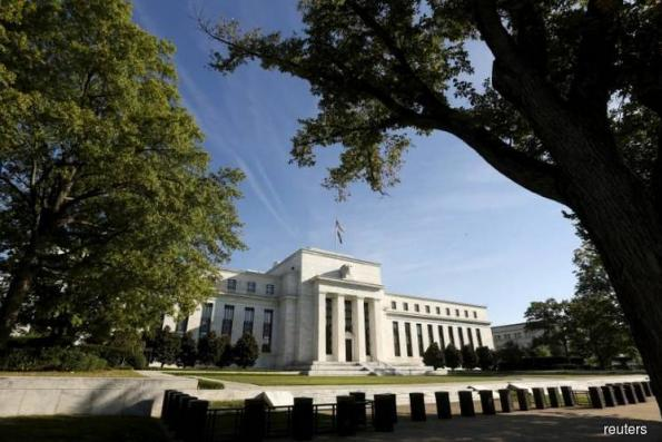 With rate hike in the bag, Fed may hint at Trump effect on economy