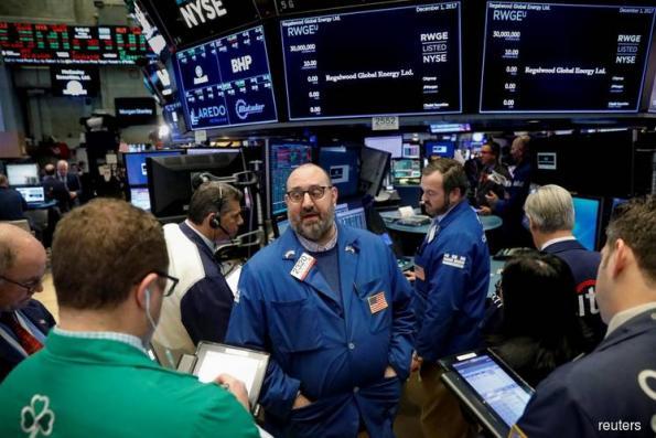U.S. stocks rise in volatile trading, bonds drop
