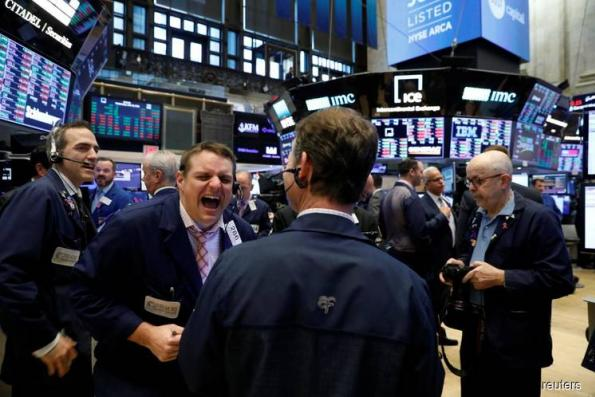 Wall Street gets lift from strong earnings at end of rough month