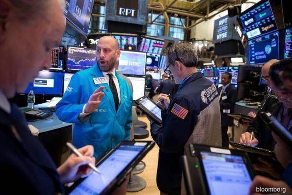 U.S. stocks fall; dollar strengthens, oil sinks