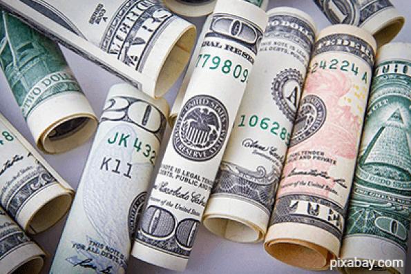 US dollar slips amid Trump's hardening policy defence, yen benefits