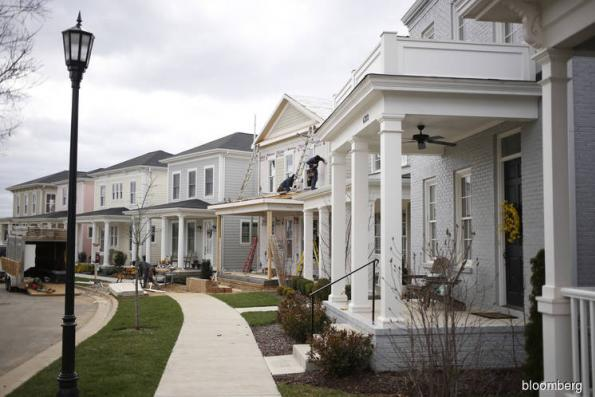 US June new home sales at eight-month low; May data revised lower