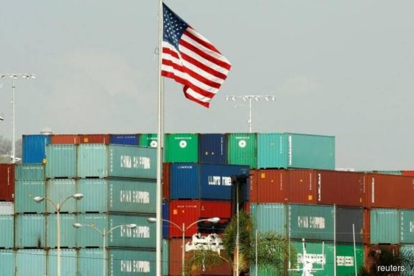 US economic growth slows in fourth-quarter on surging imports
