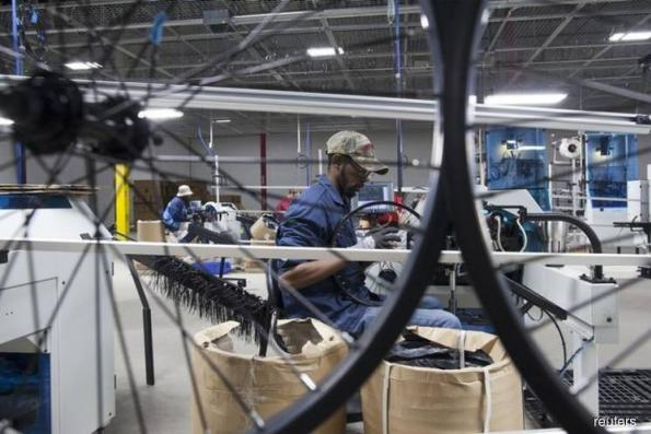 U.S. factory activity slows; private payrolls increase